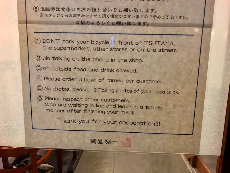The door to the restaurant has this list of rules prominently displayed on it.