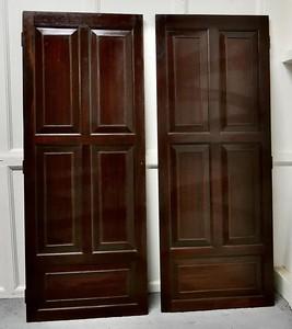 salvaged mahogany doors turned into bar
