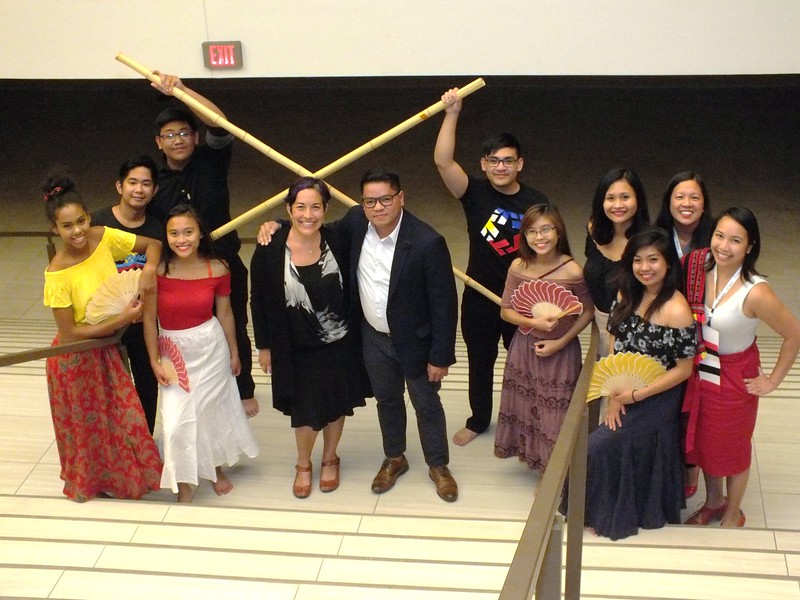 Local Filipino American Students from the University of New Mexico (UNM) entertain the JCLC 2018 attendees during their Ethnic Affiliates Gathering with traditional folk dances. Standing in the center are APALA Vice President/President Elect, Alanna Akio Moore and APALA President Paolo P. Gujilde.