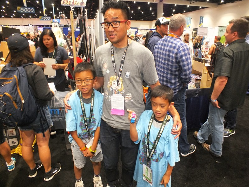 Popular local  FilAm artist, Patrick Ballesteros, poses with young Viet-Pino fans, Cleto and Liam Nguyenphuoc from Gardena, CA.