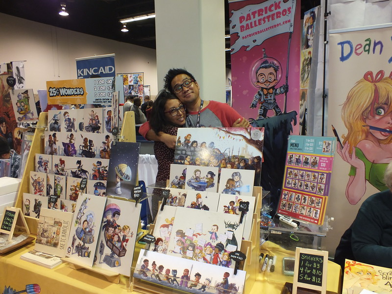 UC Irvine Kababayan alumni, Patrick Ballesteros with his business partner wife, Kay, hit the Wonder Con exhibit floor running with his 25cent wonders artwork. So popular with attendees that he often runs out of some of his works.