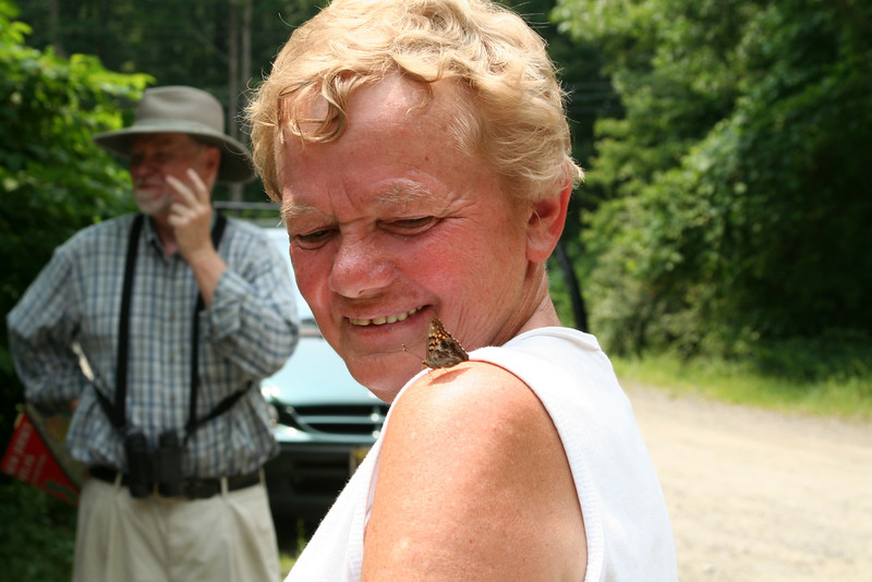 Jennie Harrington with a friendly tawny emperor, <i>Asterocampa clyton</i>.