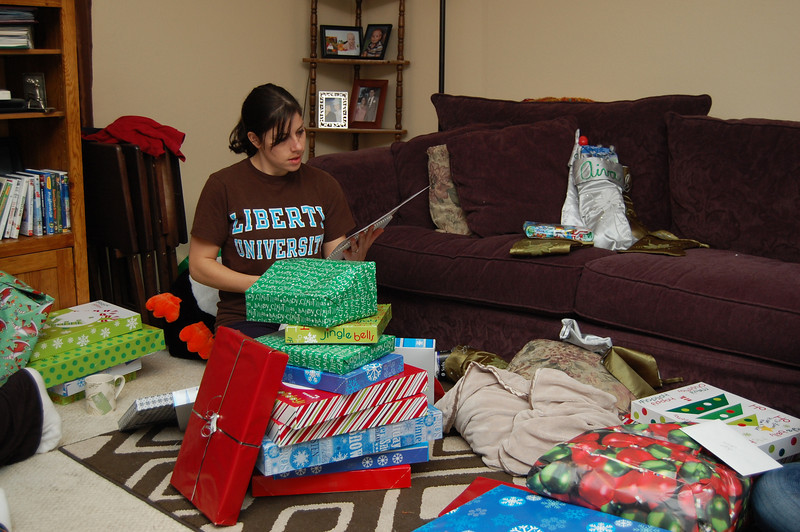 Kayna opening Levi's presents since he was taking a nap during gift time.
