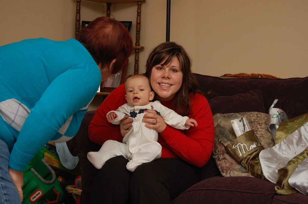Sarah and Levi getting ready to open presents.