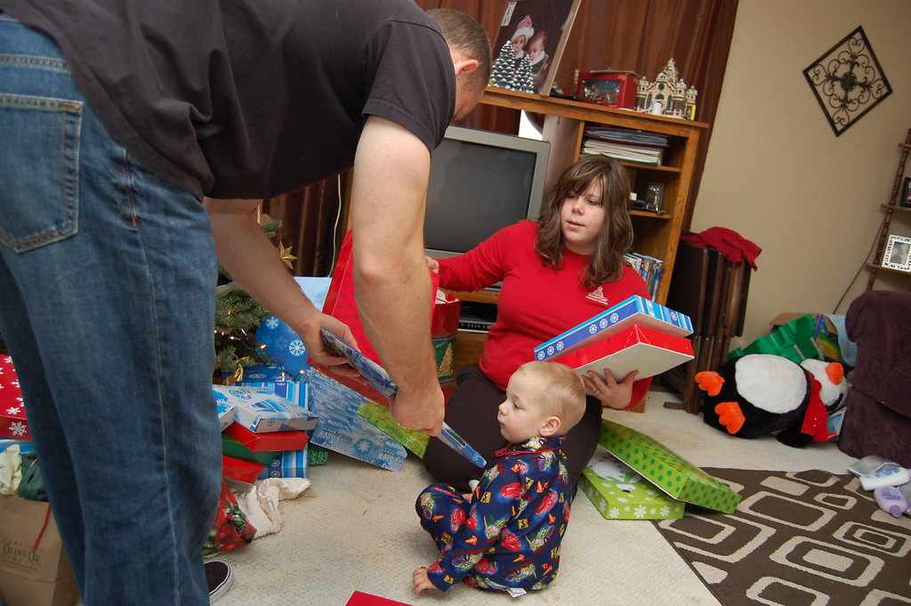 Ben getting his first present to unwrap.