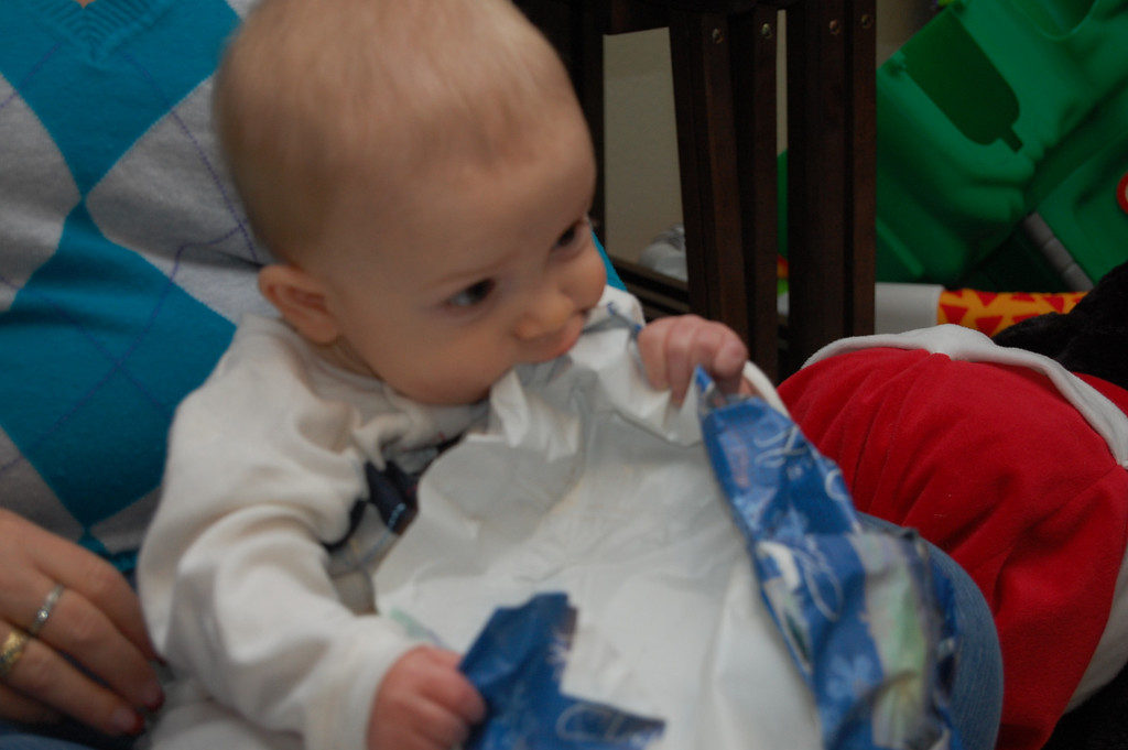 Levi eating his wraping paper.