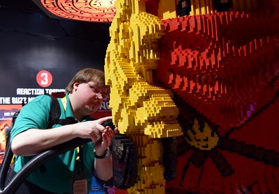Clint Parry, master model builder, gives Kai the ninja a touch up before the opening of the new Ninjago Training Camp at Legoland Discovery Center Michigan at Great Lakes Crossing Outlets in Auburn Hills on Friday, March 24, 2017.