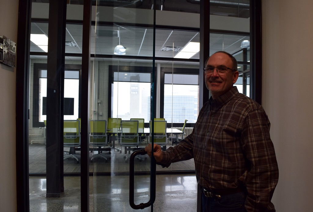 . Mark Hillman, MadDog Technology cofounder, outside the company�s new offices on the 10th floor the Riker Building, 35 Huron St. in downtown Pontiac on Monday, March 13, 2017.