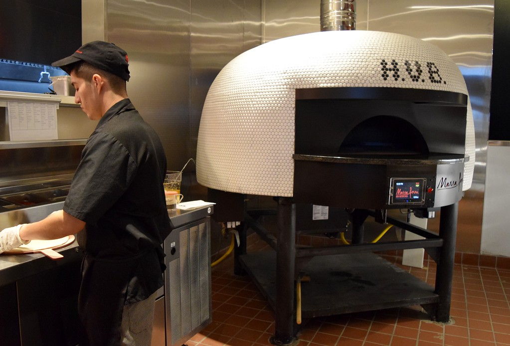 . A custom pizza oven, which rotates the pizza inside cooking it in 90 seconds, at The HUB Stadium at 2550 Takata Drive in Auburn Hills on Wednesday, Jan. 4, 2017.