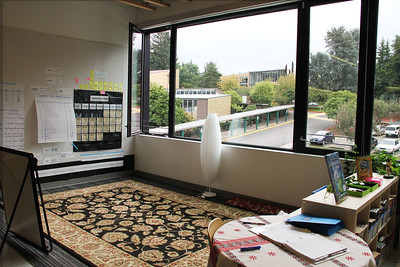A classroom setup overlooking the covered walkway, with the Upper School in the distance.