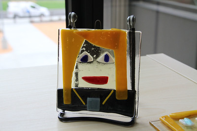 Currently on display in the main foyer are tack-fused glass portraits created by fourth graders.