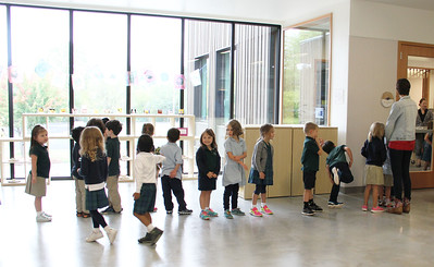 Mrs. Breiten's Kindergarten class stands in the main foyer of the building as they prepare to enter the Library.