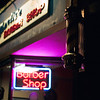 <b>Barber Pole</b> - I like this photo because the normally bright and moving barber pole seems muted next to the neon sign of the (closed) barber shop.