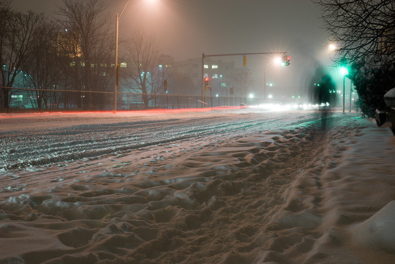 <b>Tough Going</b> - Normally busy streets are traversed by only a few during snow storms.