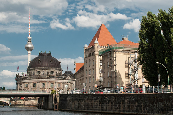 View from the River Spree of the Bode Museum (left foreground) and the Television Tower in former East Berlin.  Berlin, Germany