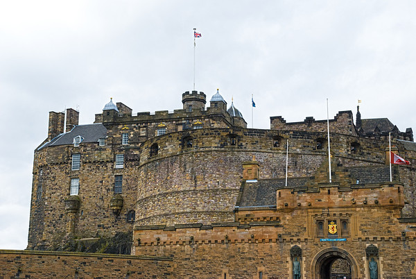 Edinburgh Castle  Gatehouse (foreground), Half-Moon Battery and the Royal Palace (background)  Edinburgh Castle is a fortress which dominates the skyline of the city of Edinburgh, Scotland, from its position atop the volcanic Castle Rock.  There has been a royal castle here since at least the reign of David I in the 12th century, and the site continued to be a royal residence until the Union of the Crowns in 1603.