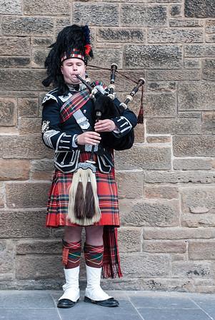 Edinburgh, Scotland  A bagpiper busking with the Great Highland Bagpipe on the street in Edinburgh, Scotland.