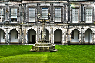 Palace of Holyroodhouse  View of the quadrangle designed by Sir William Bruce.  Located at the bottom of the Royal Mile in Edinburgh, at the opposite end to Edinburgh Castle, Holyrood Palace has served as the principal residence of the Kings and Queens of Scots since the 16th century, and is a setting for state occasions and official entertaining.