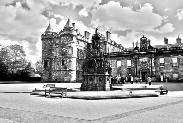 Palace of Holyroodhouse  Forecourt Fountain  Located at the bottom of the Royal Mile in Edinburgh, at the opposite end to Edinburgh Castle, Holyrood Palace has served as the principal residence of the Kings and Queens of Scots since the 16th century, and is a setting for state occasions and official entertaining.