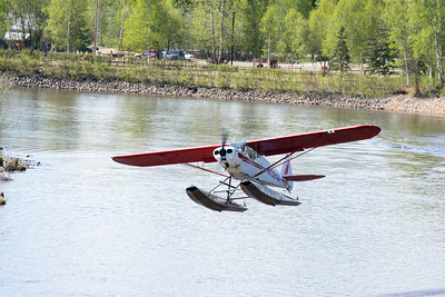 Riverboat Discovery  A bush pilot performs multiple  take-offs and landings on the Chena River.  Fairbanks, Alaska