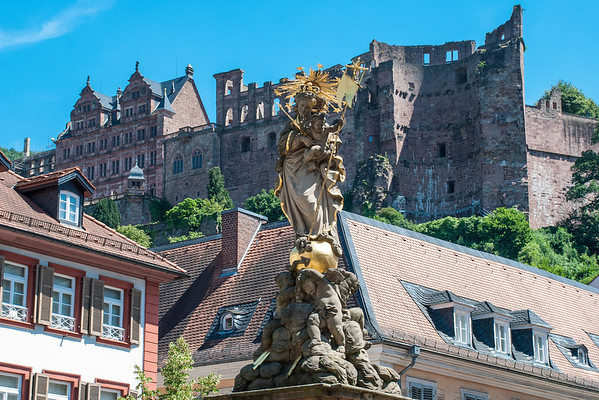 Heidelberg Schloss (castle) in the background.  Corn Market Madonna (foreground).  Heidelberg, Germany