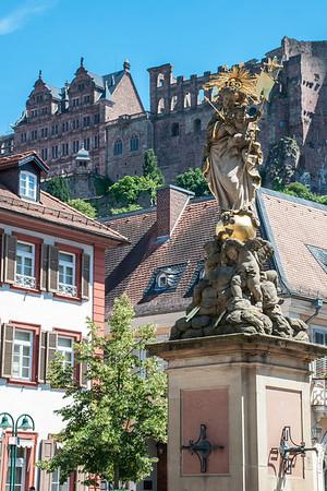 Heidelberg Schloss (castle) in the background.  Corn Market Madonna (foreground).  Heidelberg, Germany
