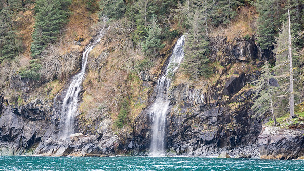 Waterfalls  Waterfalls flow from the coastal rainforests into Resurrection Bay.  Kenai Fjords National Park Seward, Alaska