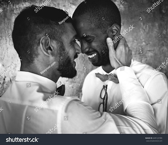 stock-photo-gay-couple-smiling-together-black-and-white-649123789