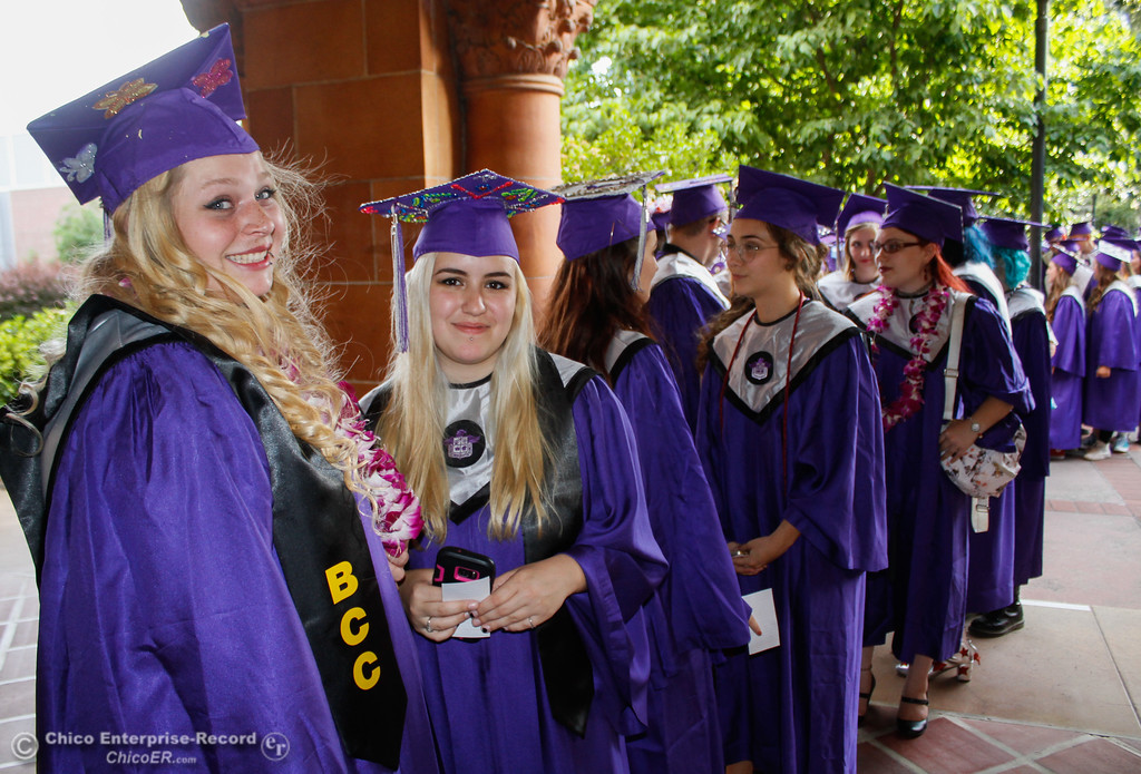 . Butterfly Legar and Hannah Jones lead the line of Inspire School of Arts & Sciences graduates into the commencement ceremony Tuesday June 6, 2017 in Chico, California. (Emily Bertolino -- Enterprise-Record)