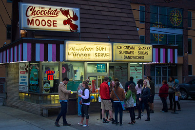 At dusk, the people of Bloomington, IN enjoy a tasty treat at the Chocolate Moose.
