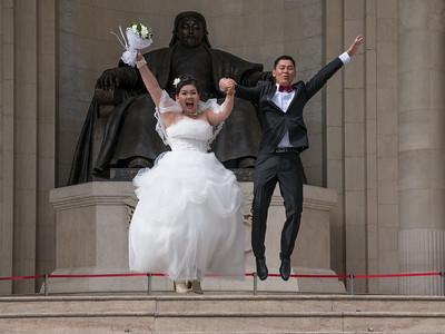 Jumping wedding couple