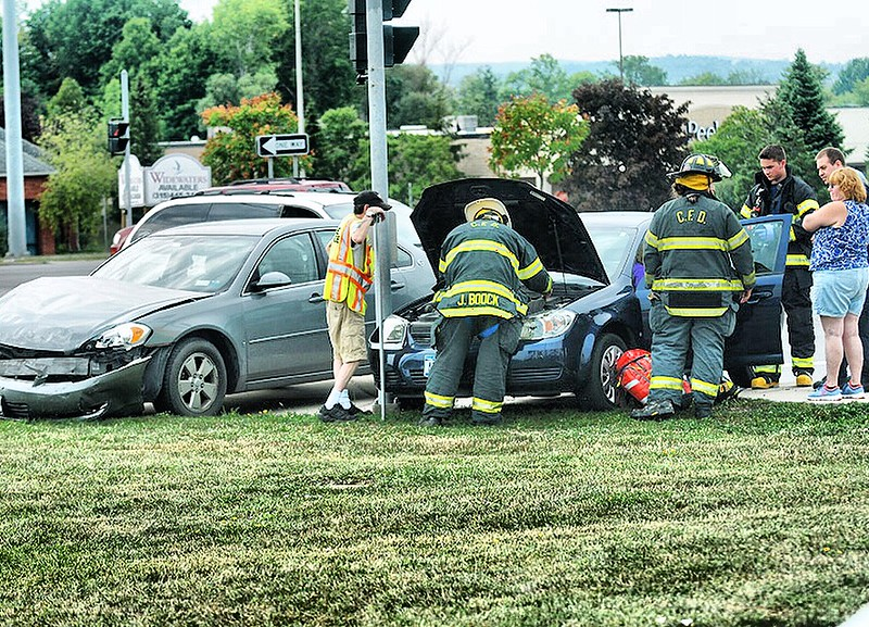 Jack Haley/Messenger Post MediaCanandaigua Fire Department and Canandaigua Emergency Squad responded to a two car MVA on County Road 10 at Routes 5&20 at lunch time on Wednesday.