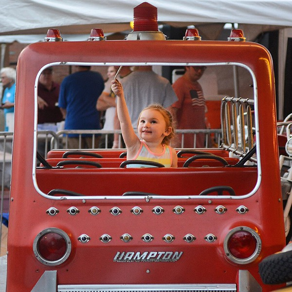 Jack Haley/Messenger Post MediaA possible future firefighter enjoying herself as she rings the bell on this ride at the St. Mary's Festival on Thursday evening.