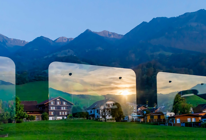 on the train to Interlaken, superimposing sunset reflection from the train window