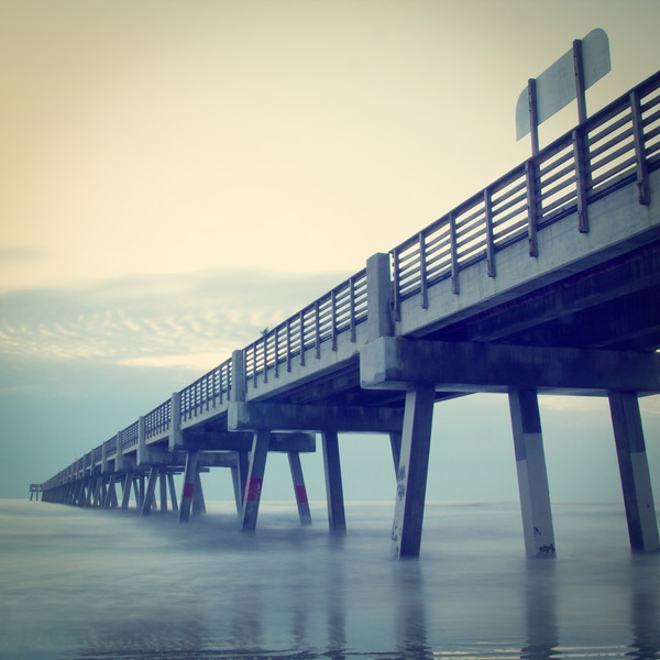 Jacksonville Beach, Florida fishing pier in early morning.