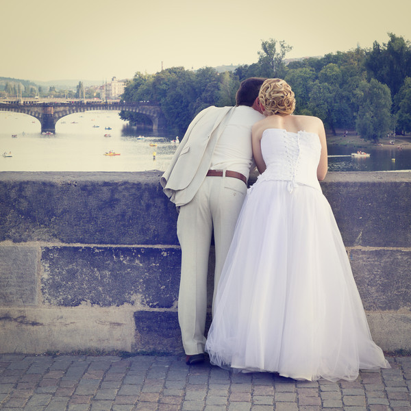 Couple on thier Wedding Day on the Charles Bridge in Prague, Czech Republic.