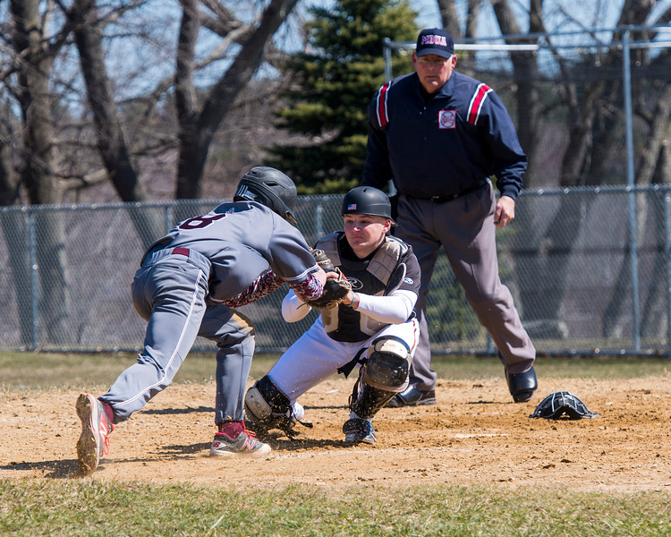 Harrison LaPierre puts a tag on Stang's Max Winterhalter to give the Sachems a shutout win on opening day.