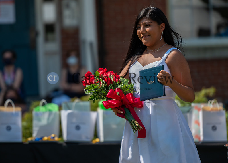 Zitlaly Carranza recieves her diploma during the Institute of Notre Dame's Class of 2020 graduation ceremony July 26, 2020 at Notre Dame of Maryland University in Baltimore. (Kevin J. Parks/CR Staff)