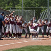 Chico State Wildcats #22 Claire Wayne (center) leaps into home plate after hitting a 2-run home run against Sonoma State Seawolves in the bottom of the second inning during their first softball game of a doubleheader on Friday, April 13, 2018 in Chico, Calif. <br /> (Jason Halley/University Photographer/CSU Chico)