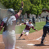 Chico State Wildcats #20 Kristin Worley (center) slides in to home plate to score against Sonoma State Seawolves in the bottom of the third inning during their first softball game of a doubleheader on Friday, April 13, 2018 in Chico, Calif. <br /> (Jason Halley/University Photographer/CSU Chico)