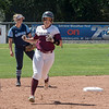 Chico State Wildcats #22 Claire Wayne (center) rounds second after hitting a 2-run home run against Sonoma State Seawolves in the bottom of the second inning during their first softball game of a doubleheader on Friday, April 13, 2018 in Chico, Calif. <br /> (Jason Halley/University Photographer/CSU Chico)