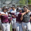 Chico State Wildcats #17 Amanda Flores (left) and #22 Claire Wayne (right) embrace against Sonoma State Seawolves in the bottom of the third inning during their first softball game of a doubleheader on Friday, April 13, 2018 in Chico, Calif. <br /> (Jason Halley/University Photographer/CSU Chico)