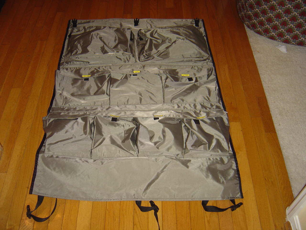 Lay the camper caddy with the pockets facing up
