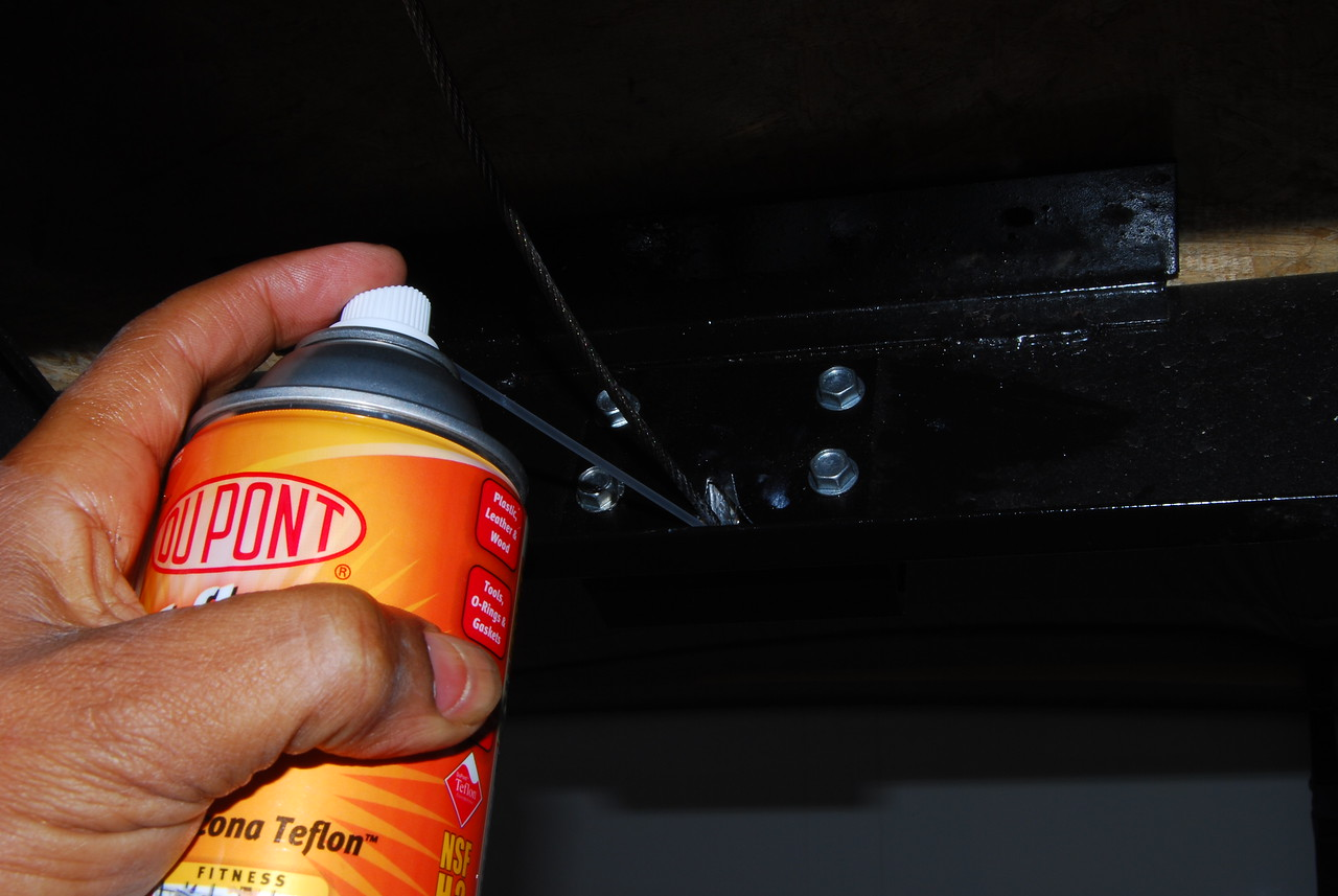 Apply a silicone spray to the four pulleys that are at the bottom of the roof lift assembly.