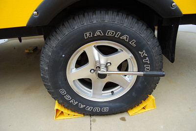 Use a lug tool to loosen the lug nuts.  You should not use the torque wrench to loosen the lugs or as a socket wrench.  Also do not torque a wheel that is hot.