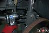 Next remove the brake flex line attachment bolt