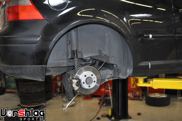 The rear suspension is a fairly simple beam axle in the rear. To remove the shocks first the lower shock bolts were removed.