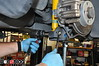Tighten the lower shock bolts to the factory torque specs.