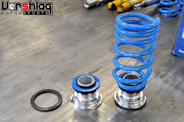 This shows the Bilstein included rear springs + adjustable ride height platforms used. The rubber gasket isolates the ride height adjuster from the chassis (optional) and the blue friction disc is used underneath the spring.