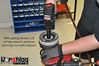 With the spring sufficiently compressed away from the top mount, loosen the top nut with an IMPACT wrench. You cannot do this with hand tools without damaging the shaft. Pulse the impact gun a few times and the nut should come right off. MAKE SURE the spring compressor has the spring pulled away from the top mount!